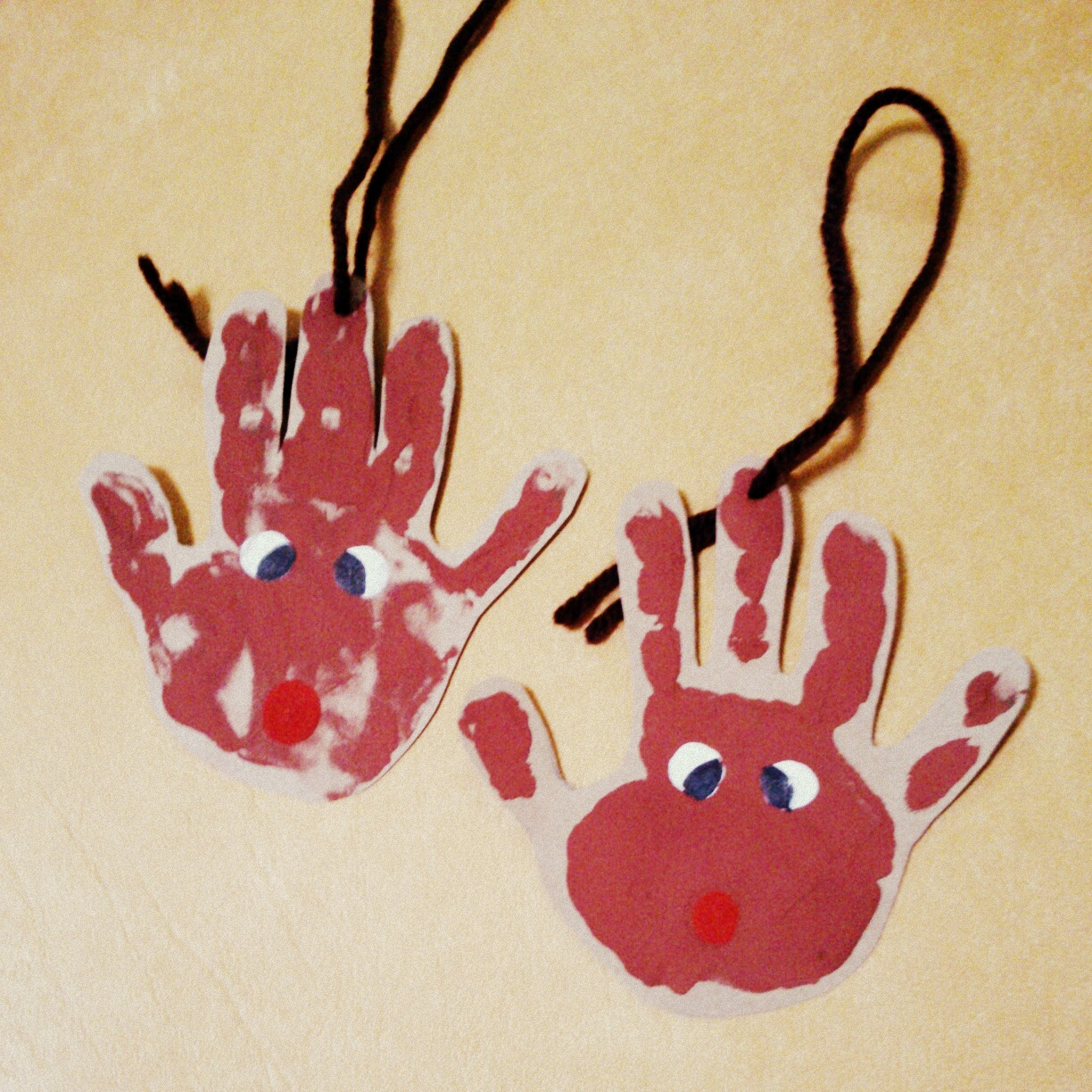 Today we received our gifts from my 2-year old nephew, Liam:  hand-made Christmas tree ornaments made with his hand print.  Cool!