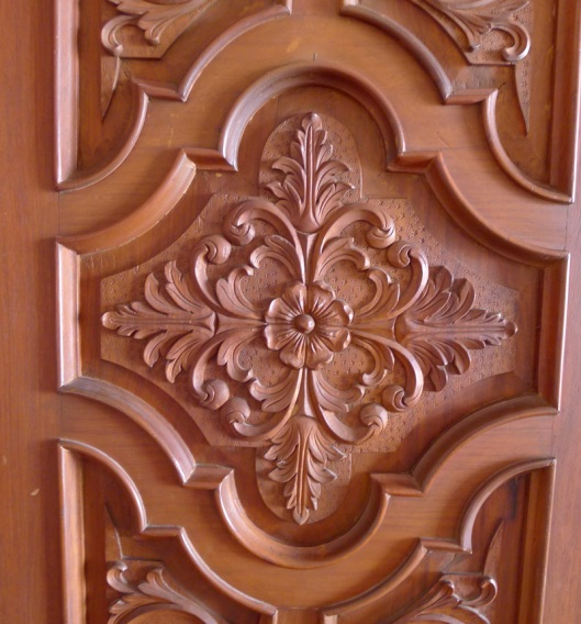 Beautiful floral design in one of the carved wood doors in the mansion.