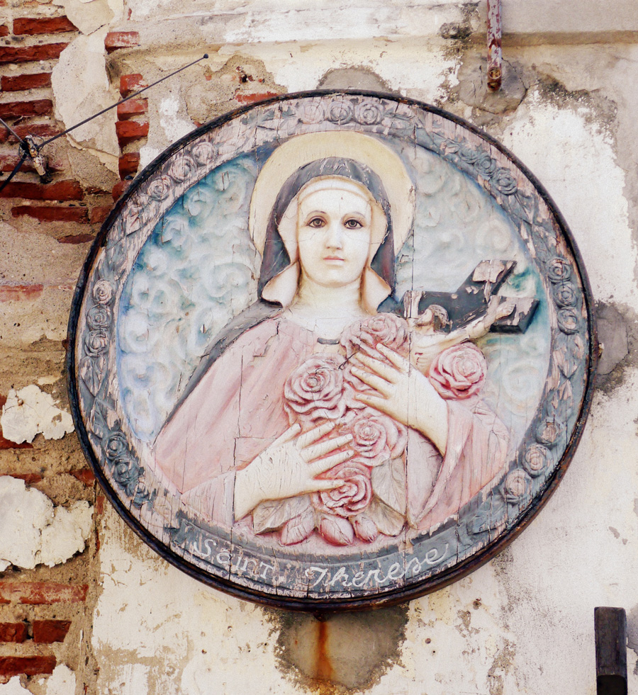 St. Therese of Liseux carved into one of the walls along Calle Crisologo.