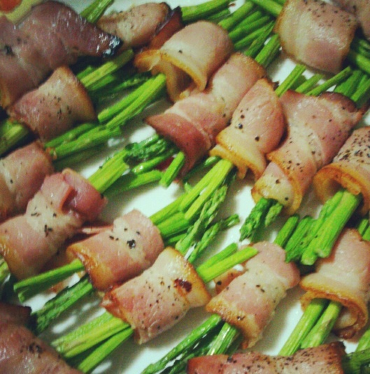 Bacon-wrapped Asparagus Sticks.  So simple to make and yet it's the bestseller!   Just wrap asparagus sticks with bacon, drizzle with olive oil, sprinkle with some pepper and pop into your oven or oven toaster.  Cook in high heat until bacon is cooked.