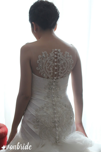 On bride Kristine.  A back details are both chic + fierce!