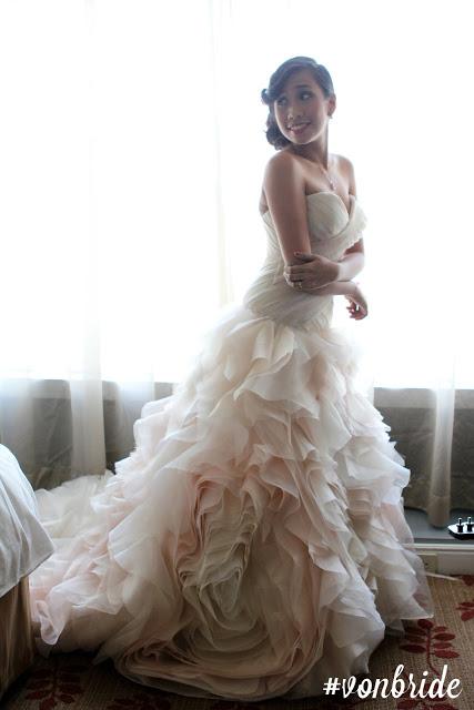 On bride Shane.  I heart the layered fabric skirt!